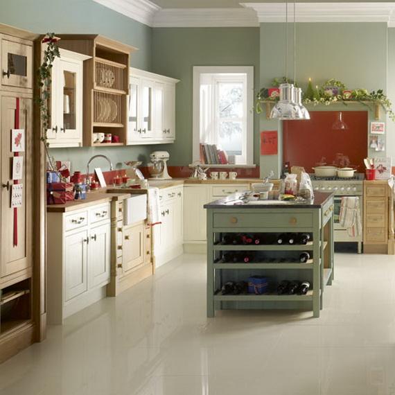 المطبخ يتميز انه علي لونه الطبيعي وهو لو الخشب وجزء منه ملون بالاوان هادئه وجميله واستايل المطبخ جديد وبسيط ويناسب الشقق الكبيره .