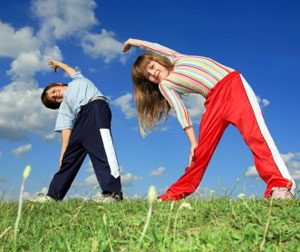 gymnastics-kids-exercising-small
